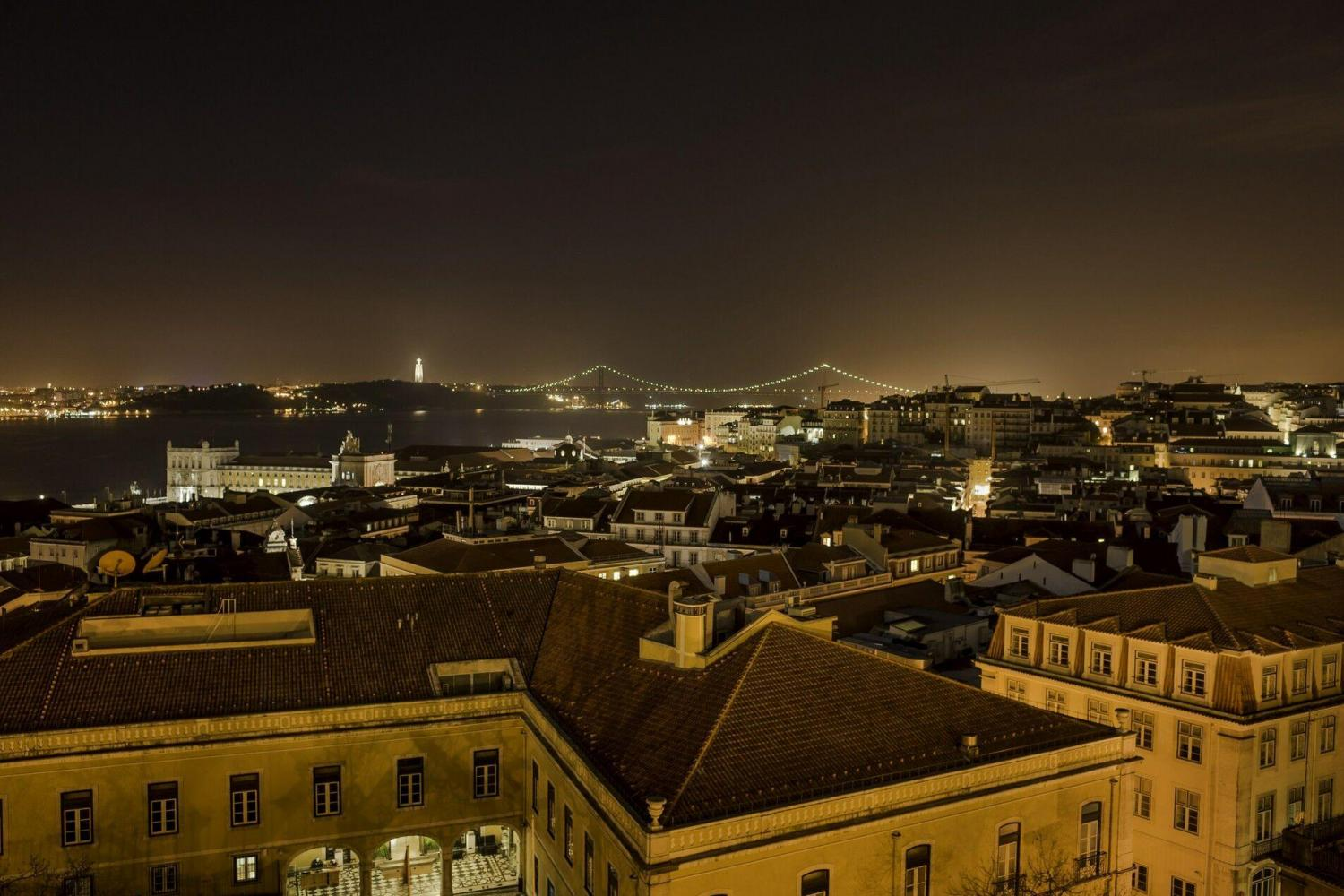 Look out across the city for the beautiful glow of Lisbon at night