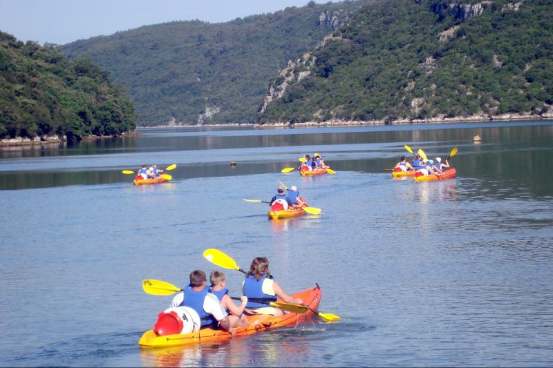 Experience an unforgettable adventure in a sea kayak along the protected area of Lim bay