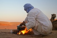 Bedouin making a dinner in middle of the desert in Egypt