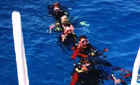 Divers in Dahab, Egypt