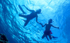 Children swimming in the Red Sea, Egypt