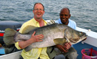 Fisherman with Nile Perch, Lake Nasser, Egypt