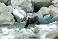 Trekker drinking from a Glacier stream, Nepal
