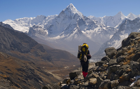Trekker with Ama Dablam in the background, Everest region, Nepal