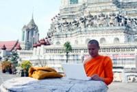 A Thai Buddhist Monk in Wat Arun, Bangkok, Thailand