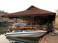 Floating house on Si Nakharin reservoir, Thailand