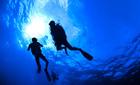 Silhouette of divers, Ko Tao, Thailand