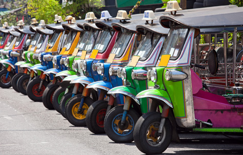 Row of Thai tuk-tuks, Bangkok, Thailand