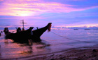 Longtail boat at sunset on Ko Samui, Thailand