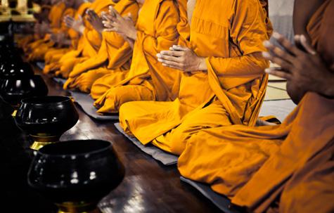 Buddhist monks praying, Thailand