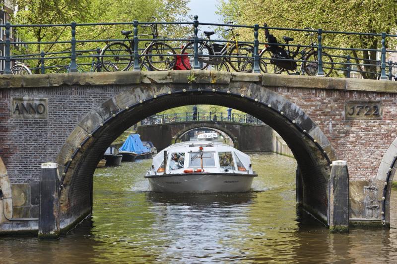 Cruising gently under Amsterdam's bridges