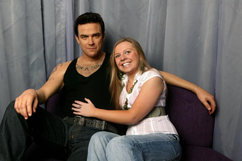 Cuddle up tot Robbie Williams at Madam Tussaud