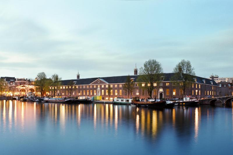 Located within the stunning Amstelhof building by the Amstel River
