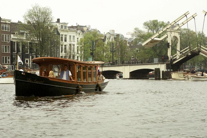 Enjoy a private canal cruise in a classic saloon steamer