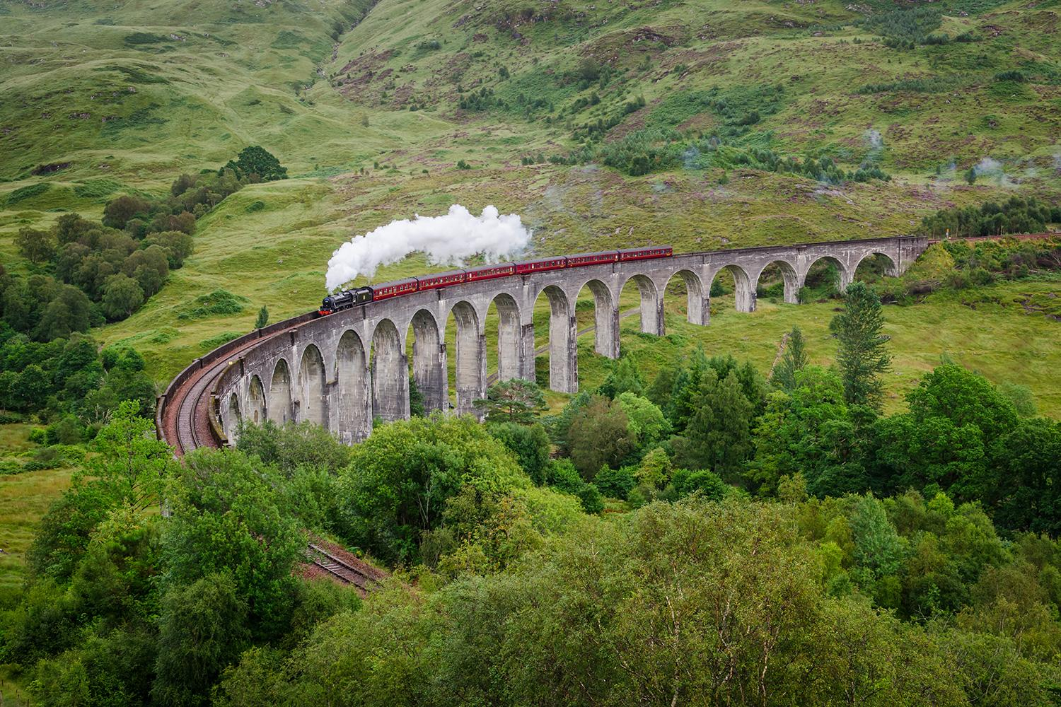 Rolling over the 21 soaring arches of Glenfinnan Viaduct on the West Highland Line
