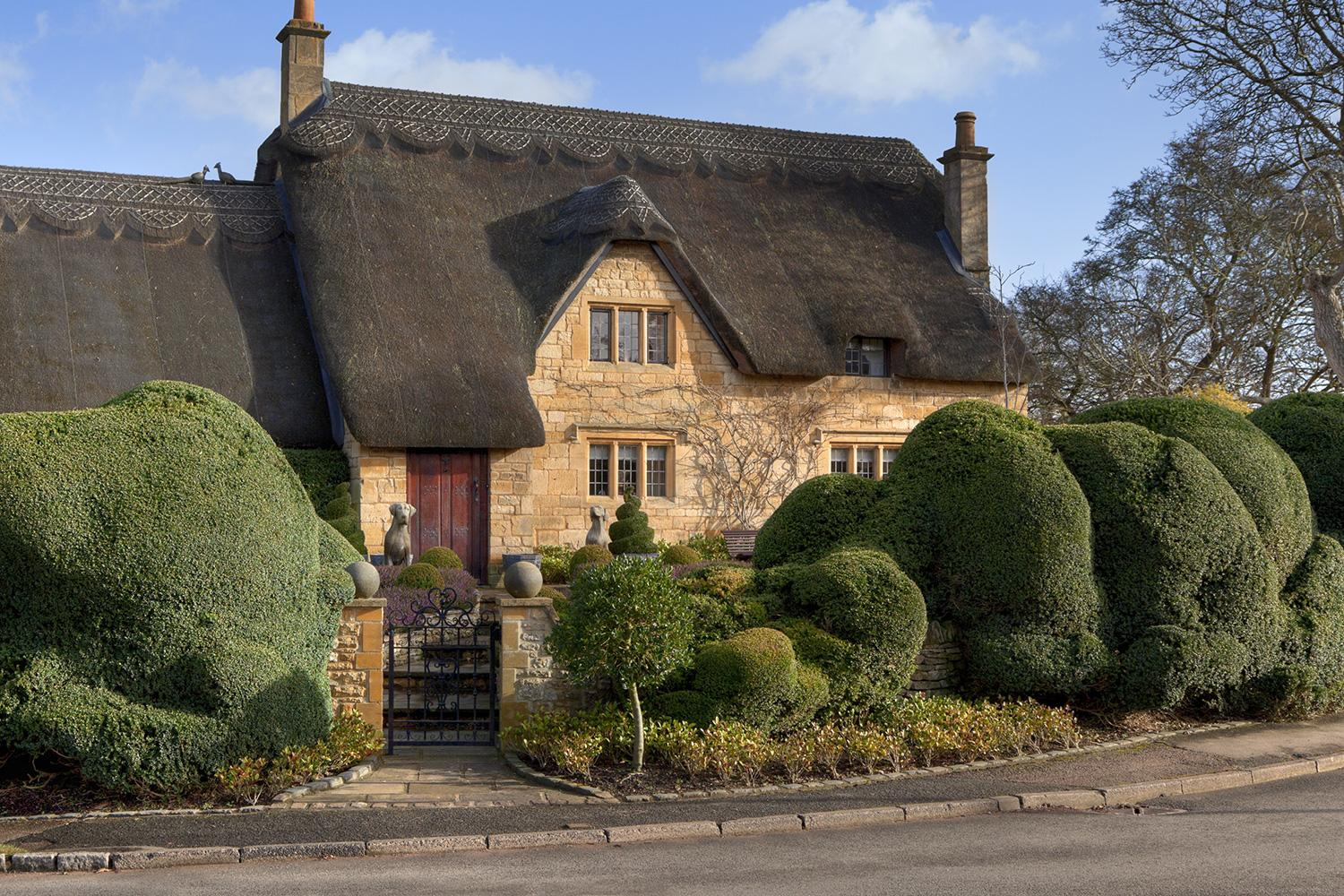 Typical thatched honey-coloured cottage