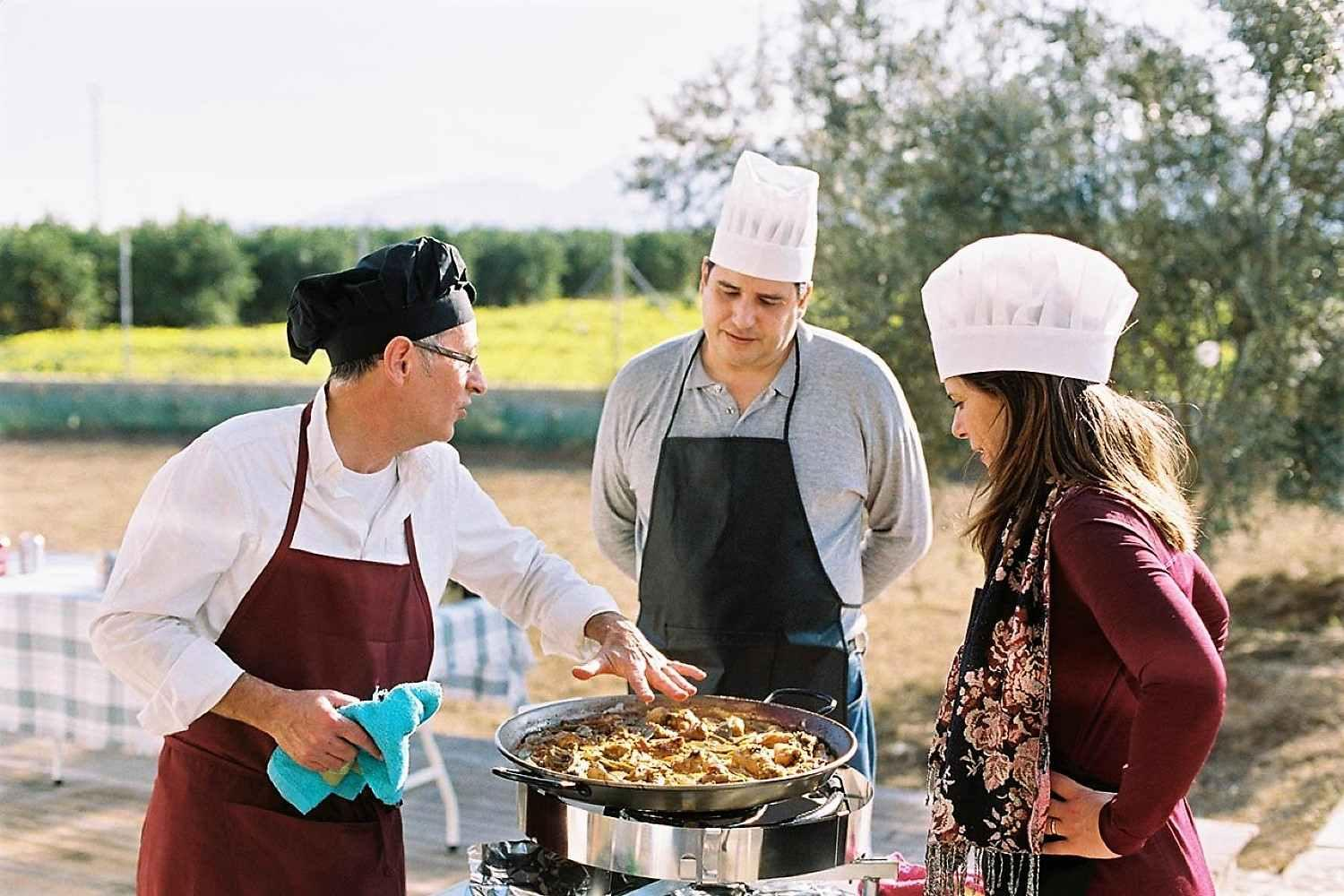 Outdoor paella cooking in Valencia