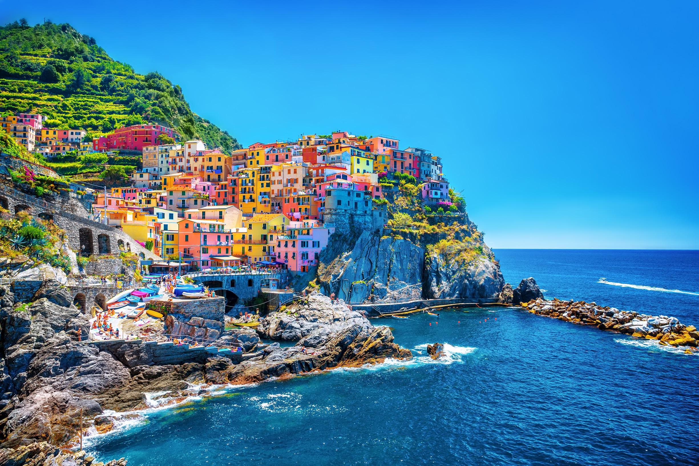 visit the four villages of Riomaggiore, Manarola, Vernazza & Corniglia