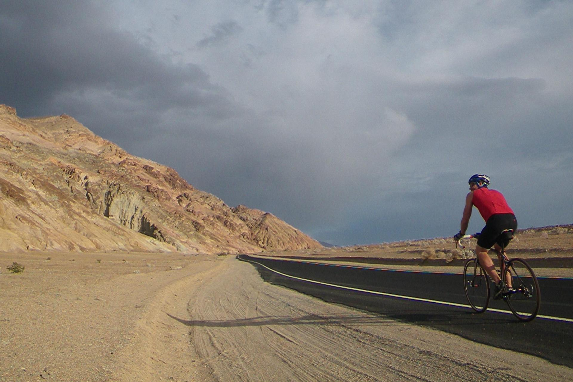 Lone cyclist on the roads of Death Valley